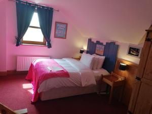 Un ou plusieurs lits dans un hébergement de l'établissement Carnately Lodge