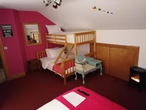 Un ou plusieurs lits superposés dans un hébergement de l'établissement Carnately Lodge