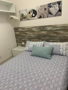A bed or beds in a room at Taormina Beach House