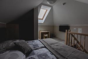 Łóżko lub łóżka w pokoju w obiekcie Avena