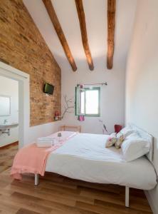 Llit o llits en una habitació de Hostal Cling 43