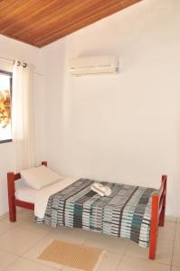 A bed or beds in a room at Suítes Maravilha de Ará