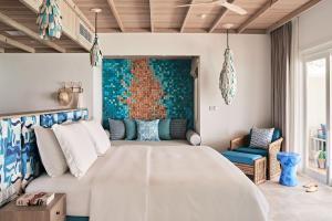 Ein Bett oder Betten in einem Zimmer der Unterkunft Finolhu Baa Atoll Maldives
