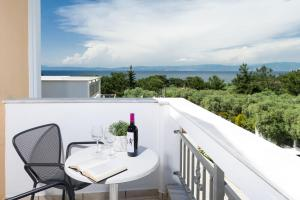 A balcony or terrace at Louloudis Boutique Hotel & Spa