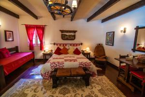 A bed or beds in a room at Pousada Villa D'Amore