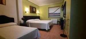 A bed or beds in a room at La Casona