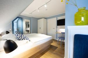 A bed or beds in a room at Ual Öömrang Wiartshüs