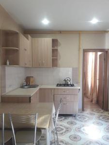Кухня или мини-кухня в Гостевой Дом Подкова