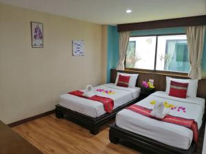 A bed or beds in a room at Mandala House, Chiang Mai