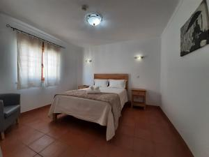 A bed or beds in a room at Sol da Vila