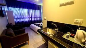 A kitchen or kitchenette at Spat Hotel Ashdod