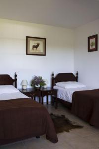 Łóżko lub łóżka w pokoju w obiekcie Kantonia