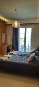 Ένα ή περισσότερα κρεβάτια σε δωμάτιο στο Angelo Hotel-Cafe