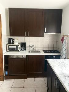 A kitchen or kitchenette at Apartment Jadranska