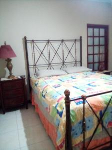 A bed or beds in a room at Home Away From Home