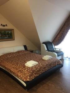 Кровать или кровати в номере Мини Отель Лагуна