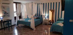 A bed or beds in a room at Suite Palazzo Luciani