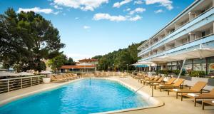 The swimming pool at or near Hotel Marina - Liburnia