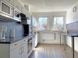 A kitchen or kitchenette at Hammerhotel - Halle Saale