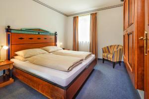 Ein Bett oder Betten in einem Zimmer der Unterkunft Hotel MONDI Bellevue Bad Gastein - OSB02094-CYC