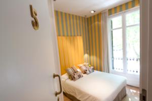 A bed or beds in a room at BacHome Terrace B&B