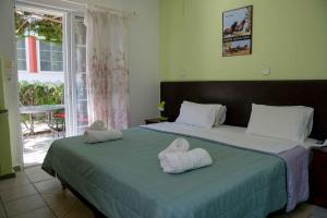 Ліжко або ліжка в номері Melissa Gold Coast