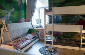 A bunk bed or bunk beds in a room at KINDheitstRAUM