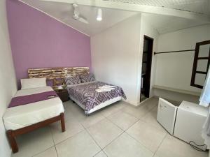 Cama ou camas em um quarto em VOA Che Buzios
