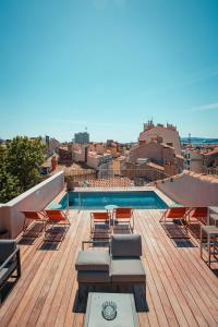 The swimming pool at or close to Grand Hôtel Dauphiné, Boutique Hôtel & Suites