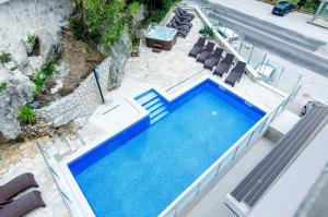 Vue sur la piscine de l'établissement Villa Babilon ou sur une piscine à proximité