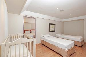 A bed or beds in a room at Rede Andrade Braz