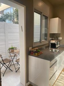 A kitchen or kitchenette at klil hacoresh suite eilat