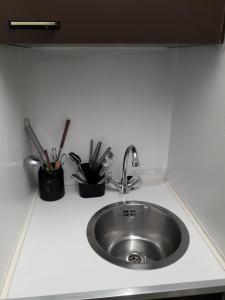 A kitchen or kitchenette at Ferienappartement mit Sauna