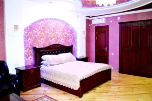 A bed or beds in a room at Shohkand Hotel