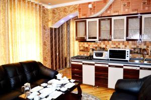 A kitchen or kitchenette at Shohkand Hotel