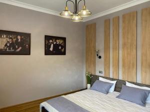 Кровать или кровати в номере Отель Бристоль Центральный