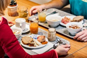 Breakfast options available to guests at Nordic Hostel - das Zuhause für Sportler