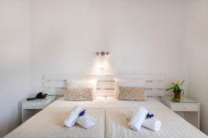 Letto o letti in una camera di Stella Hotel