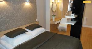 Łóżko lub łóżka w pokoju w obiekcie Apartament Platynowy Dwupoziomowy z Garażem Podziemnym Centrum Zielonej Góry