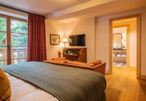 A bed or beds in a room at Chalet Griffin