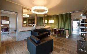 A seating area at Villaverde Hotel Spa&Golf Udine