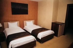 Кровать или кровати в номере Гостиница НН18