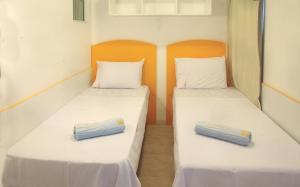 Cama ou camas em um quarto em Residence Village