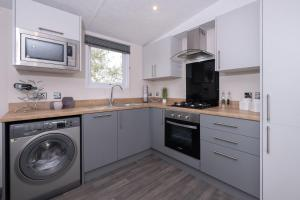 A kitchen or kitchenette at Brackenborough Hotel