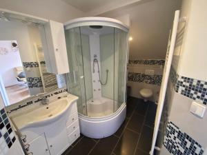 Koupelna v ubytování Penzion Sofinata & Trattoria Lucio Špindlerův Mlýn