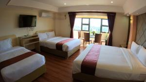 A bed or beds in a room at 456 Hotel