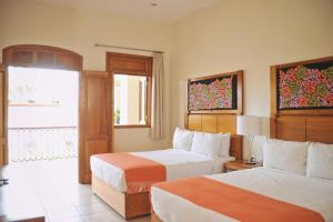 A bed or beds in a room at XTILU Hotel - Adults only -