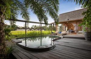The swimming pool at or near Blue Karma Dijiwa Ubud