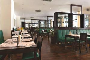 Ein Restaurant oder anderes Speiselokal in der Unterkunft Flemings Hotel München-City