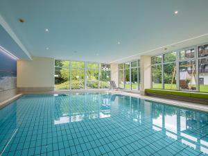 The swimming pool at or near Johannesbad Hotel Königshof